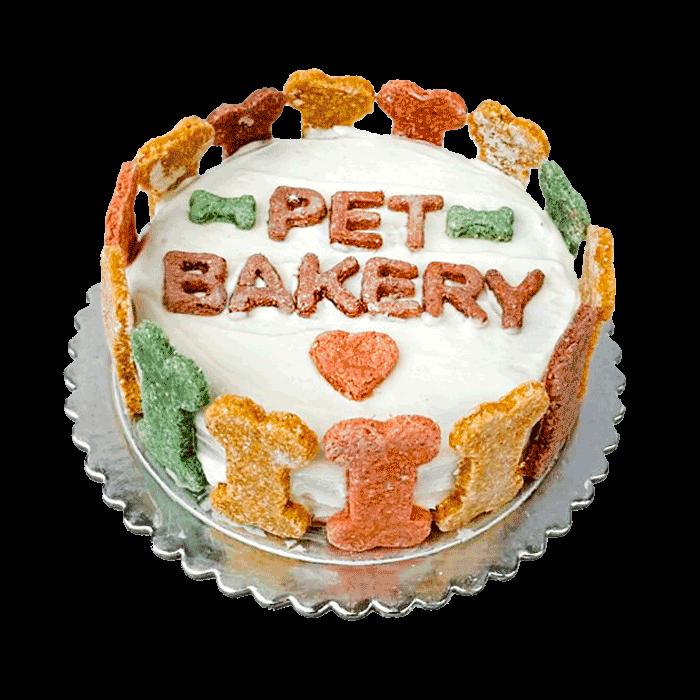 Imagen de Torta Pet Bakery con glasé blanco y galletitas verdes y amarillas