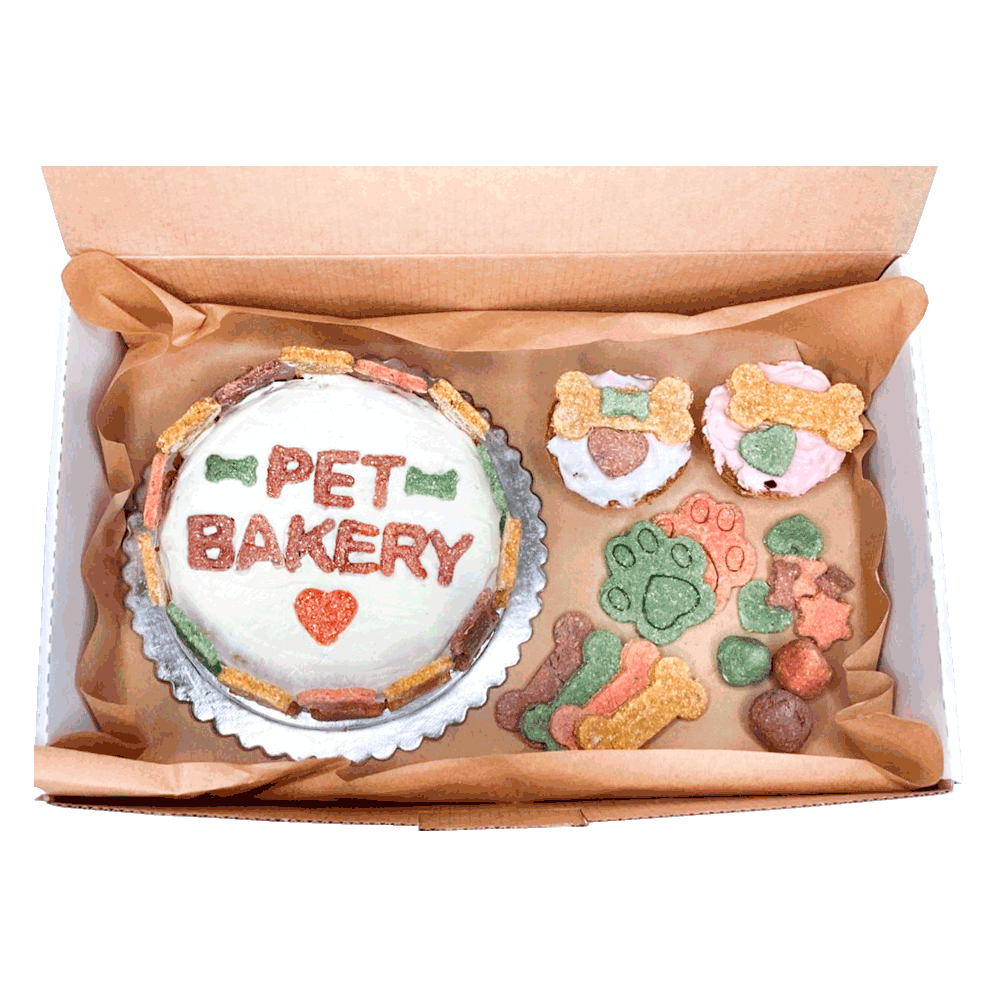 Imagen de Roccobox Grande Pet Bakery que contiene una torta grande, un pack de galletitas y dos muffins para perro